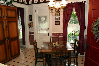 The kitchen nook with its antique pull-out table is a less formal dining option.