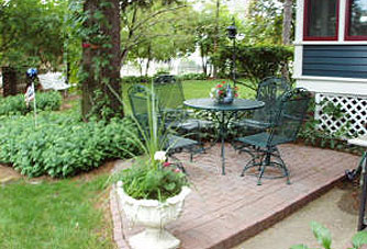 A patio provides a lovely place to rest and view the Victorian gardens.