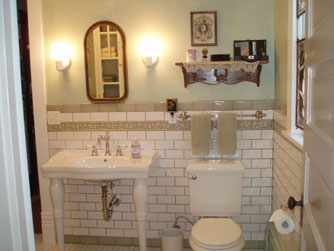 A large bathroom on the main floor is shared between Gareld's Room and the Maids Quarters.