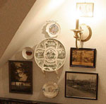 Antique pictures and collectible plates form a collage on the Heritage Suite's private sitting room wall.