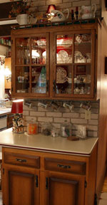 This glass-door cabinet was built by Bonnie's father.