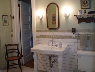 A large bathroom on the main floor is shared between the Maids Quarters and Gareld's Room.