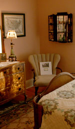 A wing-back chair tucked into the corner gives you a pleasant spot to read about the house's history.