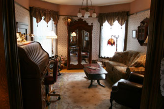 The den is off the main parlor area, and can be closed off with pocket doors.