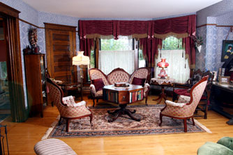 Reproduction Furniture In The Parlor Matches The House Perfectly.