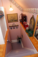 The back stairs has more of an attic feel, but is a showcase spot for antique art and memorabilia.