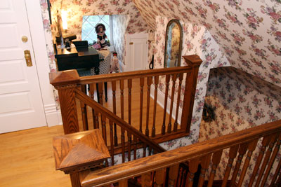 A dormer at the top of the third floor stairs is an enticing spot for the child in all of us.